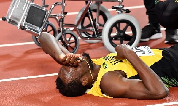 Usain Bolt tuvo una triste despedida al lesionarse en su última carrera - Noticias de justin gatlin